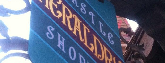 Castle Heraldry is one of Disneyland Shops.