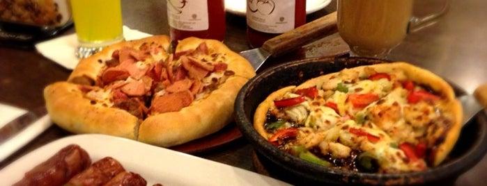 Pizza Hut is one of wajib.